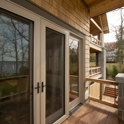 Silver Lake Residence - Pinnacle clad casement, awning, direct set, and swinging patio doors by Windsor Windows & Doors.