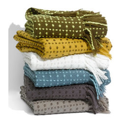 Checker Throw - Throws are great to have around anytime of the year, especially in springtime when the days are warm but the nights can still be a little chilly.  This cute checkerboard styled throw is made of soft yarn and has lots of fun fringe.