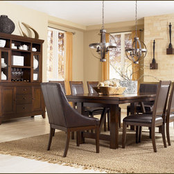 "Ashley Holloway Dining Room Collection - With a warm cottage design bathed in a woody medium brown finish that flows beautifully over the thick profile table top, the ""Holloway"" Dining Collection captures an inviting relax style that is sure to fit comfortably within the décor of any home."