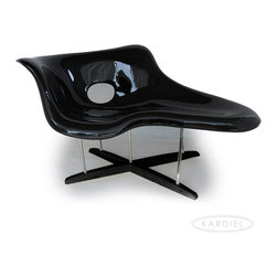 "Kardiel Eames Style La Chaise Lounge Chair Fiberglass, Black/Walnut Stained Wood - Sculpturally windswept, the 1948 Eames La chaise was more of an art piece than a chair. The design, built around the concept of reverse sculpting the human form, provides a flowing, ergonomically superior lounge experience. Charles and Ray created the piece for the Museum of Modern Art, despite demand it could not be sold at that time. The complex design proved too expensive to produce until decades later. Multiple fiberglass shells are bonded together to create a comfortable depth to the touch. Separated by a hard rubber disk, the void between the two shells is filled with Styrene, just as in 1948. The free flowing design is built to platform the relaxed human form. The shell with its curved waterfall edges is suspended by 5 strategically placed diagonally solid steel posts. 3 attach in a direct vertical fashion to the Solid Walnut cross intersecting platform below. The right facing ""front"" two rods cross in the center before attaching. The Kardiel reproduction of the 1948 La Chaise follows to exacting detail, both dimensions and materials used in the crafting of this modern classic. Today as then, it is a sculpture first, and a chaise second."