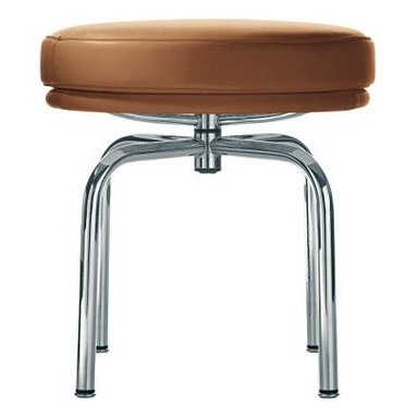 Cassina - LC8 Swivel Stool - The LC8 Swivel Stool (1928) represents the designer's interest in exploring the structural possibilities of tubular steel and was designed to mirror the (LC7) swivel chair. The LC7 Swivel Chair (1928) evolved from one of a number of experiments, including an attempt to fashion a chair by wrapping inner tubes from tires around a steel frame. As the Le Corbusier group refined such trials, a sensuous solution took form. A round, thickly padded seat rests on top of a curving claw-like base of tubular steel that resolves in a swivel mechanism, giving the seat pad a buoyant look. A curved, amply padded barrel, doubling as backrest and chair arms, links three tubular steels supports that fuse at the seat base. The result has become one of modernism's most familiar icons. Each piece is signed and numbered and, as a product of Cassina's Masters Collection, is manufactured by Cassina under exclusive worldwide license from the Le Corbusier Foundation. Made in Italy.