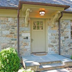 HeartWood Traditional Doors - Custom mahogany door with 6-lites over a bead board panel.