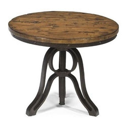 Magnussen Furniture - Cranfill Round End Table - Constructed from Hardwood and Pine Solids and Metal Base. All pieces feature a metal base. All pieces feature solid pine on top. All pieces feature adjustable level feet. Aged Pine Finish. Hardwood and Pine Solids, with Metal base and Adjustable Leveler. Aged Pine Finish. 1 Year Limited Warranty. 24 in. W x 24 in. D x 24 in. H (57 lbs.)Restoration style has an updated new attitude. Our casual Cranfill group features a central threaded post not unlike those found on turn-of-the-century bankers stools. In an Aged Pine veneer over select hardwood, with adjustable level feet.