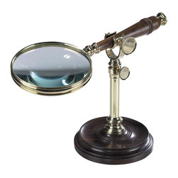 "Authentic Models - Magnifying Glass With Stand - Don't strain your eyes while reading your favorite novel, book or newspaper. Use this lovely and elegant magnifying glass with stand. This Decorative stand is made from hand turned hardwood and the bronze clamp lined with soft leather to avoid scratching of the wood handle; Made of wood, brass and glass. Dimensions: 9 3/4"" Length, 4.5"" Height and 7"" Width."