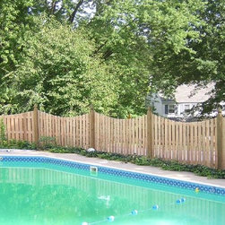 """4' Cedar Scalloped Board on Board - This Cedar fence is 4' tall and features a scalloped top. It can come with 2"""" or 1 1/2"""" spacing."""
