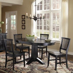 Home Styles - Arts and Crafts 5 Piece Dining Set - Mission Styling at its best! The Arts & Crafts Five Piece Dining Set is an economical solution capable of adapting to a variety of settings. Constructed of hardwood solids and engineered wood, the Round Dining Table can be accessorized either formally or informally to create any desired atmosphere. The 16'' leaf expands the table top from 42'' to 58'', providing enough space for two additional chairs. The Arts & Crafts Dining Chairs are constructed of hardwood solids and can be purchased, in addition to the four included in the set, in two pack quantities. Five piece set includes the dining table and four dining chairs. Features: -Set includes dining table and four dining chairs.-Hardwood solid and engineered wood construction.-Arts and Crafts collection.-Collection: Arts and Crafts.-Distressed: No.-Powder Coated Finish: No.-Gloss Finish: No.-Top Material: Hardwood solids.-Base Material: Hardwood solids.-Chair Material: Hardwood solids.-Solid Wood Construction: No.-Reclaimed Wood: No.-Number of Items Included: 5.-Scratch Resistant: No.-Rust Resistant: No.-Leaf Included: Yes -Number of Leaves: 1..-Seating Capacity: 4.-Wine Storage: No.-Shelving: No.-Drawers: No.-Stemware Holder: No.-Upholstered Side Chair: No.-Upholstered Arm Chair: No.-Upholstered Bench: No.-Cushioned Chair Seats: No.-Chair Casters: No.-Lighted: No.-Outdoor Use: No.-Commercial Use: No.-Recycled Content: No.-Eco-Friendly: No.-Product Care: Clean with damp cloth.Specifications: -ISTA 3A Certified: Yes.Dimensions: -16'' Leaf expands the table top from 42'' to 58'' to allow for seating for two more!.-Overall Table Dimensions: 30'' H x 42-58'' W x 42'' D.-Overall Chair Dimensions: 35.75'' H x 17.75'' W x 22.25'' D.-Table: -Overall Table Height - Top to Bottom: 30.-Overall Table Width - Side to Side: 42.-Overall Table Depth - Front to Back: 42.-Overall Table Weight: 112..-Side Chair: -Overall Side Chair Height - Top to Bottom: 37.75.-Overall Side Chair Wi