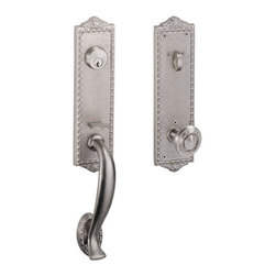 Crestview Entry Handleset - With delicate egg and dart stylings on the edges of its plates, this set is sure to bring elegance to your entryway. Features a sculpted exterior grip handle, as well as the renowned ribbon and reed pattern on the interior knob.