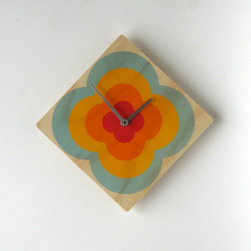 Echo Flower Wall Clock by Objectify - New Zealand designers Objectify have just released a new collection of retro-inspired wooden clocks. They're colorful and funky and for any space.