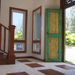 Mokuleia - Antique Javanese entry door with custom Merbau window trim and stair case.