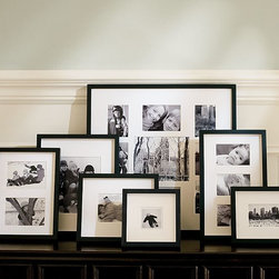 Wood Gallery Multiple Opening Frames, Black - Simple black gallery frames with white mats surrounding candid family photos are, hands down, my favorite additions to family room display units. Leaning and layering different sized frames inside a built-in media unit or bookcase creates a casual but eye-catching personal gallery.