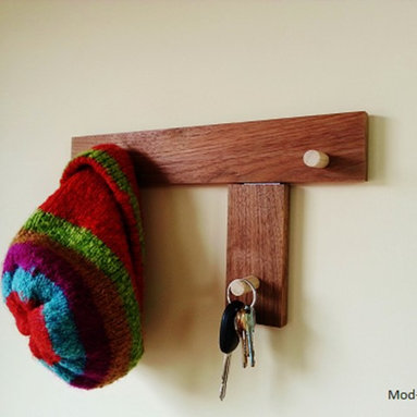 Wall Mounted Coat Rack and Key Hanger by Mod-Rak - This reclaimed wood, walnut, wall mounted coat rack also works great as a key holder or leash hanger. 3 handmade, hardwood hooks are recessed for added strength. Eco friendly sealers offer a healthier alternative to more harsh chemical sealers. This Mod-Rak comes with 2 installed keyhole hangers for sturdy mounting, screws, anchors and wall bumpers.
