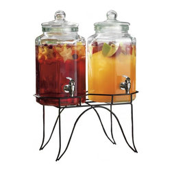 "Home Essentials - Set of Two Iced Tea Drink Dispensers on Stand - Hostessing is a breeze with this Dual Beverage Jugs on Rack. This 2 gallon glass drink dispenser is a party workhouse the frees you up from bartending duties so you can enjoy the indoor or outdoor partying. The clear double drink dispenser with turn spout comes with a stand to provide you the combination of convenience and looks. Fill those servers up with iced tea, sangria, water, lemonade or even kombucha and let the spout provide your guest with all they need. * Each jug holds 1 gallon * Stainless Steel Coated Spout * Dimensions: W: 6.5"" D: 6.5"" H: 12.5"""