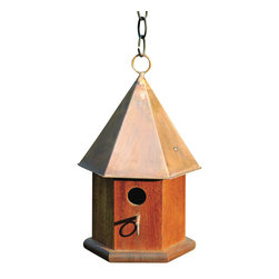 Heartwood - Copper Songbird Birdhouse Mahogany - The  hexagonal  body  of  this  copper  songbird  home  is  sure  to  please  the  gardener  or  bird  lover  in  your  life.  Made  of  solid  cypress  and  equipped  with  a  six-sided  solid  copper  roof,  it  is  available  in  other  colors.  Hanging  loop  and  matching  copper  perch  help  to  complete  the  look,  with  easy  cleanout  and  optional  easy  mounting.          Product  Details:                  7x7x15              Available  in  verdigris  roof,  brown  roof  or  solid  mahogany  with  bright  copper  roof              Handcrafted  in  USA  from  renewable,  FSC  certified  wood