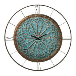 Moroccan Medallion Clock - The rustic colors of the Moroccan Medallion Clock make this a natural choice for any wall. Four abstracted Roman numerals lend a hand to telling the time, while the arabesque pattern draws your eye into the discreet black hands. Hang above the bed, and allow time to pass you by in the most luxurious of manners.