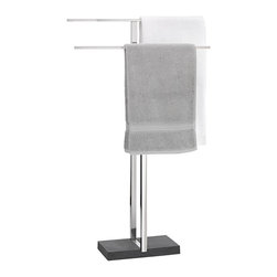 Blomus - Blomus Menoto Towel Stand Multicolor - 68664 - Shop for Towel Bars Hooks and Rings from Hayneedle.com! Large windows in the bathroom are perfect for a lot of reasons - just not for hanging towel rods on the wall. The Blomus Menoto Towel Stand lets you have your natural light and dry off too. With or without large windows in the bathroom this towel stand offers greater flexibility in terms of how you have your bathroom laid out so you can be sure your towels are close to the shower or tub where you need them most. The heavy-duty polystone base provides a sturdy structure that won't tip as you pull towels off or hang them on while serving as a handsome accent that will stand out in your bathroom's contemporary decor. The stainless steel rods have a clean modern look and give you ample room to store and air out two to four large bath towels lengthening the life of the towels and requiring them to be washed less frequently because of a musty build-up.About BlomusBased in Sundern Germany Blomus is an international designer of functional and decorative stainless steel products for the home interior and exterior. Their aim is to harmonize form and function to create special products for everyday life such as kitchen accessories wellness elements patio accents and decorative items. Their designs soften the cold and sterile edge of stainless steel by combining it with other materials. For Blomus design is not an end in itself but an important part of everyday life.