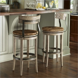 Lexington Twilight Bay Dalton Bar Stool in Driftwood - The concave back and serpentine vertical supports on the Dalton Bar and Counter Stools lend a softness to the silhouette that is enhanced by the round shape of the hand-woven rush swivel seats. The Driftwood finish highlights the use of metal on the backs of the stools and kick plates.