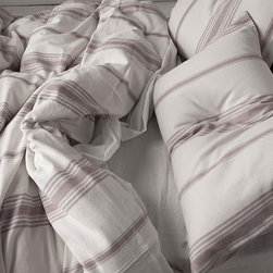 Elsa Duvet Cover - This duvet cover harkens back to older times with its traditional ticking pattern, while still remaining current and modern with its simplicity. This looks like another duvet that could lure me into lying in bed all day.