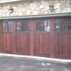 Carriage House Doors - this is a double wide overhead door with a faux finish and false centerpost to give the impression of two separate swing-out style doors.
