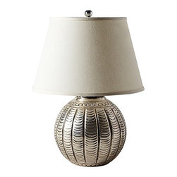 Hammered Metal Lamp, Scallop - If an exotic feel would fit your room scheme better, look for hammered-metal bases like this one from Serena & Lily.