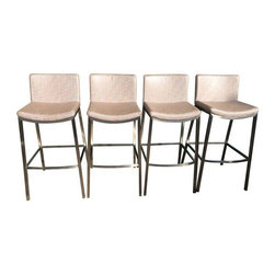 "Pre-owned Stainless Steel & Leather Bar Stools - Set of 4 - A set of four brand new custom bar stools. The stools feature a clean and contemporary modern design. The stools have stainless steel metal frames and convenient built-in footrests. The seats are beautifully upholstered in smooth metallic faux leather in ""oyster"". The fabric is a high end fabric from Osborne & Little. The barstools are light in weight, but sturdy and the seats are softly padded and comfortable.       Seat dimensions: 16""D x 16""W x 28.5""H  Footrest: 12""H"