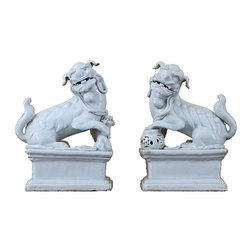 Frontgate - Set of White Porcelain Foo Dogs - Set of two. Crafted of porcelain. Handmade and hand-painted so each item is unique. Clay is sculpted, polished, fired, painted and glazed. Male and female dogs represent traditional Chinese concepts of yin and yang. Chinese guardian lions, or foo dogs, have watched over sacred and imperial buildings for centuries. This Pair of White Porcelain Food Dogs is well suited to stand guard in your entry or atop your mantel and add a superb decorative look to your home. The male lion is depicted playing with a ball, which represents the world and serves to protect the building, while the female lion has a cub under her paw and is believed to protect the people.  .  .  .  .  . Please note: Color and size may vary slightly due to handcrafted nature.