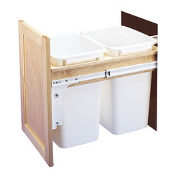 "Rev-A-Shelf - Rev-A-Shelf 4WCTM-18DM2 Double 35 Qt Top Mount Pullout Waste Container - White - This series of Top Mount Slide Out Waste Containers are a great addition to every kitchen. The Double 35 Quart White Pullout Trash Containers make for a nice base cabinet organizer. This sturdy Rev-A-Shelf 4WCTM-18DM2 unit is constructed with solid hardwood maple lumber and a clear UV-coat for protection. You will also receive full extension of the unit with the 150 lb. rated steel slides, and built-in door mount brackets for easy installation to your cabinet door face. Also, the rear mounting brackets are adjustable allowing for installation in various cabinet depths. Cover lids and cabinet door face are not included. Size Specifications: 15"" W x 22-1/2"" to 24"" D x 17-7/8"" H. Please make sure you have a minimum cabinet opening of at least 15"" W x 22-1/2"" D x 18"" H to ensure a proper fit."