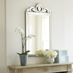 Ballard Designs - Nicola Venetian Mirror - Rubbed antique gold edge. Beveled edges. Venetian mirrors have been prized for centuries for their fine quality and intricately crafted details. Our Nicola Mirror captures that old world elegance in a surprisingly modern silhouette. The beveled center glass is framed in lightly antiqued faceted mirror and crowned in a foliate fleur-de-lis with reverse-etched beading. Nicola Venetian Mirror features: . .