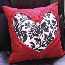 """Winter 2012 - Love is in the air, and this pillow cover certainly sets the mood! A unique gift idea for your honey, this pillow is handcrafted to the t. A red velvet ruffle is made by hand in the shape of a heart. Then a black and white floral cotton fabric is applied in the ruffled """"window."""" A leather flower finishes the ensemble."""