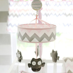 My Baby Sam - My Baby Sam Pink Chevron Mobile - MB172 - Shop for Mobiles from Hayneedle.com! Lull your little one to sleep with the sweet My Baby Sam Pink Chevron Mobile. Four adorable owls hang delicately from the pink and gray chevron designed canopy. Playing Brahms Lullaby when wound up this cute mobile is sure to be a hit during nap time. Spot clean with a cloth only. Fits any standard sized crib.About My Baby Sam Inc.My Baby Sam was dreamed up by mom-of-three Tori Swaim in 2001. My Baby Sam provides a fun and diverse selection of baby bedding and kids room decor at an affordable price. With their bedding nursery and kids decor letters and baby gifts My Baby Sam products will help you create a dreamy nursery or your child s first big-kid room.About New Arrivals Inc.New Arrivals Inc. was started 15 years ago by mom-of-three Tori Swaim. What started as a small accessory and gift product line has grown into hundreds of products including bedding nursery and kid s room decor letters and baby gifts. New Arrivals Inc. is your one-stop-shop to designed and outfit the baby nursery or kid s room of your dreams.