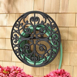 Frontgate - Scroll Aluminum Hose Holder - The Scroll Aluminum Hose Holder adds a functional and decorative touch to the garden. Beautifully hand-crafted of rust-free cast aluminum, its graceful scrolled design imparts luxurious style to outdoor maintenance.