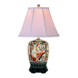 "Lamps Plus - Asian Imari Ginger Jar Porcelain Table Lamp - This exquisite table lamp is perfect for an Asian-themed or eclectic style living room or bedroom. Inspired by Imari porcelain that came from the Japanese town of Arita it features a mini vase porcelain base decorated in a colorful pattern. A black stand and off-white bell shade finish off this wonderful piece. Porcelain base. Off-white supreme satin empire shade. Takes one 150 watt maximum bulb (not included). 3-way switch. 25 1/2"" high. 16"" wide. Shade is 8"" across the top 16"" across the bottom and 12"" on the slant.  Porcelain base.   Off-white supreme satin empire shade.   Takes one 150 watt maximum bulb (not included).   3-way switch.   25 1/2"" high.   16"" wide.   Shade is 8"" across the top 16"" across the bottom"