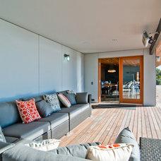 Midcentury Deck by BUILD LLC
