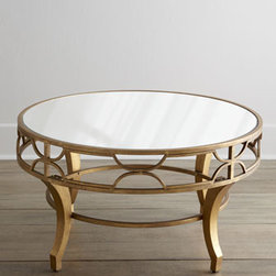 "Horchow - Lena Mirrored-Top Coffee Table - An antiqued golden finish combined with a mirrored top and fretwork apron makes this coffee table sturdy and chic. It gives any room an eclectic look. Made of metal and mirrored glass. 36""Dia. x 19""T. Imported. Boxed weight, approximately 54 lbs. ...."