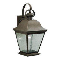 Kichler Lighting - Kichler 19-1/2-Inch Outdoor Wall Light with Clear Seeded Glass - 9709OZ - A decorative bronze finish over solid brass makes this lantern-style wall light a beautiful and durable addition to nearly any home. The light is suspended by a curled arm, which loops through a ring at the top, and a square base secures the arm to the wall. Four panes of clear seeded glass allow clean, bright light to shine through. When coupled with a single bulb, this wall light will fully illuminate any area, making it perfect for gatherings or other outdoor activities. Takes (1) 150-watt incandescent A19 bulb(s). Bulb(s) sold separately. CSA listed. Wet location rated.