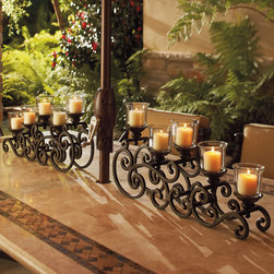 La Scala 2-pc. Tabletop Candelabrum - A romantic dinner on your terrace includes a fine wine, evening breezes, and candlelight supplied by our La Scala 2-pc. Tabletop Candelabrum. This beautifully scrolling candelabra is masterfully sculpted to provide just the right amount of aura for your outdoor dining experience.