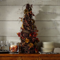 Faux Pomegranate & Pinecone Topiary - I love the height of this faux topiary. It would work great on a mantel or a buffet to add some dimension to your space.