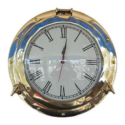 Handcrafted Nautical Decor - Brass Porthole Clock 12'' - A classy and quality accent to any  nautical themed room, the Hampton Nautical brass porthole clock is made  of polished solid brass and features Roman numerals with 15-minute  intervals. With a functional hinge and two twist screws, this porthole  clock opens to reveal the mechanism and to enable you to change the time  or batteries.------    Solid Brass no plastic parts--    Polished Lacquer      Finish for a      shine without tarnish or fading--    Pre-Drilled Holes for easy mounting--    Porthole Actually      Opens change time      without removing from wall--