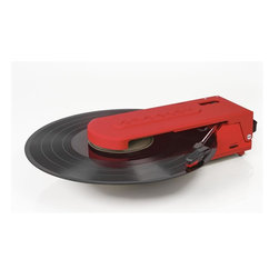 """Crosley Radio - Portable USB Turntable in Orange - Portable Turntable. USB Enabled For Connection to Windows Equipped PC and Mac. Software Suite For Ripping And Editing Audio Content. Belt Driven Turntable Mechanism. Plays 7 in. and 12 in. Records. Plays 2 Speeds - 33 1/3 And 45 RPM Records. Manual Return Tone Arm. Hi Tech ABS Construction. Diamond Stylus Needle. Battery Powered (6 AA) Required. Includes Ear Bud Style Headphones with Integrated Storage Compartment. 10.75 in W x 4 in. D x 3.25 in. H (1.5 lbs)Taking the record player """"out of the box"""", Crosley's Revolutionary turntable truly fits the word in every way. It is a turntable of firsts. The first battery powered Crosley turntable and the first with a platter smaller than a teacup saucer. Where other record players must be kept in their designated place, the Revolution, practically begs to join you on every journey. Users can tote this two-speed turntable with them to vinyl swaps, to a friends house or down to the local record store. Featuring a USB hookup for easy analog-to-digital transfer, the Crosley Revolution, will allow users to free their favorites from the grooves for digital enjoyment across a variety of devices. This small but mighty turntable also features a headphone jack, and a pair of earbud headphones."""