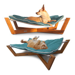 Bambu Hammock I (Berry Blue) Design By Pet Lounge Studios, Berry Blue - The Bambu Hammock's combination of clean lines, unique sleeping surface and rich eco-friendly materials make it our most sought after design. The unique sleeping surface responds to your pet's body weight which helps relieve many of the pressure points that create discomfort and often lead to arthritis. The Hammock is designed with a solid bamboo frame and a removable/reversible ultra-suede cushion which is inherently stain resistant and hypoallergenic.