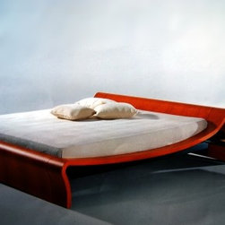 Italydesign Studios - Silhouette Bed - The Silhouette bed is produced in Italy by Angelo renowned for high quality and unique designs. The Silhouette bed is available in cherry wood, weng�, matte or shiny lacquer, ebony and leather attached nightstands are available with curved glass and wooden drawers.