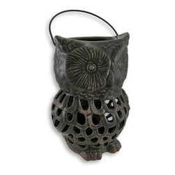 Ceramic Owl Lantern Open Work Design Dark Green - Enjoy the beautiful light show emitting from this lantern! Light flows through the cutouts and dances on whatever surface it sits on. It is hand fired and painted with a glossy enamel, and has a touch of `oxidation` to give it that weathered appeal. It measures 10.5 inches tall, 7 inches across and 6 inches deep, has a 4 inch metal handle fits up to a 4 inch thick candle. Use a piller style for full effect, or a tea light for just a hint of lighting. A fun piece for your patio or to light the way into your backyard garden oasis.