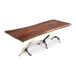 "Woodland Creek Furniture - Live Edge Table with Tree of Life Base, 108"" X 48"" - There is nothing like the beauty of natural wood. Our workshop is located in northern Michigan, and we are surrounded by some of the finest hardwoods on this earth. Take a beautiful live edge slab and pair it with a modern stainless steel base and you have a ""soft modern"" or ""organic modern"" dining table. This table design is transitional and will fit nicely into many different decors. We see our Clients using them in apartments in New York, mountain retreats in the Rockies, and ranches in Texas. Place modern chairs around a live edge table, and it will fit nicely into a modern home. Place rustic chairs around it, and it will soften a log home – it is truly a transitional design."