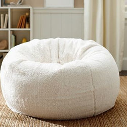 "Faux-Sheepskin Beanbag Cover, Ivory - There's not a beanbag out there that's quite as plush as this one. Wrapped in cozy faux sheepskin, it's a comfortable addition to any lounge space. 41"" diameter Made of polyester. Insert sold separately. Inserts are not intended for use without a slipcover. Machine wash. Imported."