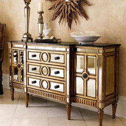 "Horchow - Gold Mirrored Console - Your favorite mirrored console now comes with a golden finish on the frame, so it's more glamorous than ever. • Hardwood frame, granite top, and beveled-mirror veneers. • Three drawers, two doors, and two shelves. • 70""W x 20""D x 38""T."