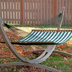 Twin Oaks Green and White Sunsharp Quilted Hammock - Curl up with a good book, or lie down for a late-afternoon snooze with the Twin Oaks Green and White Sunsharp Quilted Hammock. Sturdily crafted of hand-woven olefin rope, in striped green and white, this quilted hammock is perfect for use throughout the seasons. With two layers of weather-resistant fabric and 10 oz. poly fills, it's also highly-resistant to mold and mildew.The Sunsharp Quilted Hammock is roomy enough for two and supported by oak spreader bars, hand-finished in natural, linseed oils. Bed dimensions: 77L x 53W inches.About Twin Oaks HammocksAt Twin Oaks, they believe quality starts at the beginning - in every fiber of every rope and in every grain of every log. They start with yarn specially chosen for weather-resistance and colorfastness, and twist it into durable rope in all colors of the rainbow.Their spreader bars begin as locally harvested white oak logs, which they mill and kiln-dry on site for well-seasoned outdoor use. The completed spreaders are hand-brushed with natural linseed oil and air-dried to maintain the beauty of the wood grain.Their macrame harnesses are made by hand, and carefully measured and trimmed so that every hammock made is stable and comfortable. For their fabric hammocks, Twin Oaks chooses the best outdoor fabric in the industry, and reinforces their stitching to ensure a tough yet beautiful product that will endure the seasons. Finally, at least 40 expertly tied bowline knots complete a hammock that is sturdy and attractive.