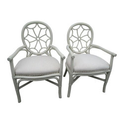 """Used Lanai Patio Chairs - A Pair - A pair of painted and upholstered patio chairs in a neutral cream color paint, and ticking cotton fabric.  These chairs would be great at a breakfast table, sitting area or office.  The extra large seat is comfortable for all, and are removable for easy care and cleaning.  The seat frame is metal. The look is somewhat bamboo with a rattan stringing at the joints, but is solid wood. The upholstery is new, the chairs are probably around the 80s. There may be minor chipping in the paint, but none is noticeable.    Seat height is 19""""."""