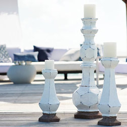 Terracotta Painted Pillar Holders - Shapely, multifaceted candle holders are dramatically scaled up, adding oversized drama to indoor and outdoor festivities. Makes an even grander statement when grouped together.