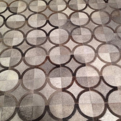 Showroom Products - This genuine hair on hide rug is made in Brazil.  This rug is made to order.  You choose the colors and the size.  Purchase at Hemphill's Rugs & Carpets Orange County, CA  www.RugsAndCarpets.com