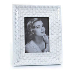 "Concepts Life - Concepts Life Photo Frame  Family Stone  5x7"" - Our take on a classic white frame, with a modern twist. The white pebbled surface adds texture and depth while the glossy finish makes your photos look radiant.  Modern home accent Contemporary white picture frame Beautiful and elegant home accent Rectangular photo frame Made of polyresin Easel back for horizontal or vertical display Various sizes available Textured glossy finish Holds 5 x 7 in. size photo Dimensions: 9""w x 11""h x 1""d Weight: 2 lbs"