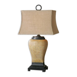 Uttermost - Melitta Ceramic Table Lamp - This distinctive lamp shows that cheeks aren't the only places dimples look good. The caramel ceramic base is finished with a light gray wash and sits on a black metal foot with yellow highlights. Put this beauty on your favorite end table and enjoy the view.